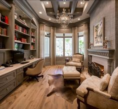 A comfortable, elegant home office with exquisite lighting and a luxury fireplace. Love everything!