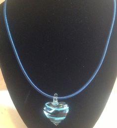 Stripy blue glass bead on an 18 inch chain. £10