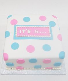 Gender Reveal Cake with pink and blue polka dots by Bake Sale Toronto.
