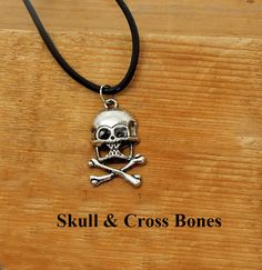 Skull and Cross Bones.  Silver skull and cross bones on 18 inches of rolled black leather.  Gift for him.  Birthday or friendship present. by BettyCampbell on Etsy