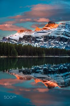 Sun rises over Two Jack Lake (Banff, Alberta) by Lou Lu