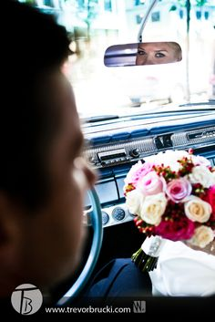 Wedding photography in Vancouver.  Cool old car with reflection in mirror.