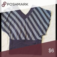 Shirt V neck back/front. Material is 62 poly, 33 rayon, 5% spandex. This is light, but more sweater material. Excellent condition! One Step Up Tops