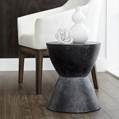 LOGAN END TABLE | BLACK | MIXT | A sculptural round end table designed for contemporary and urban spaces. Made of concrete with each finished differently for an industrial look. This end table is stocked in black, white and anthracite grey. Crafted from a natural concrete mix, each piece
