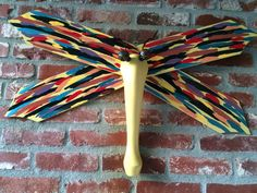 Dragonfly for Lawn, fence and garden art. Maize Ablaze original creation from ceiling fan blades and table leg is up-cycling at its best. Check it out on www.wingingthis.com