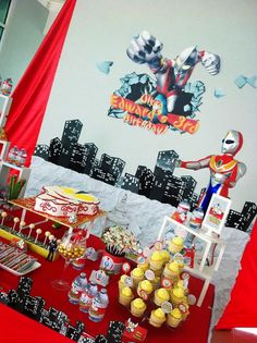 Backdrop & cake table / candy buffet for an Ultraman themed birthday party! Design & setup by ParteeBoo - The Party Designers!
