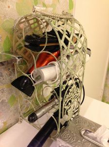Use a small wine rack to store hair dryer, curling iron and other hair tools