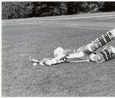 Student playing position of goalie in a field hockey game    Archives    Special Collections c289a2f5e6f67
