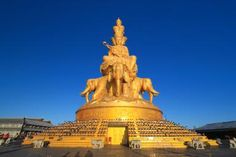 Samantabhadra Bodhisattva - Buddhist Icon of Practice: The famous landmark of the Golden Summit on the top of Emeishan or Emei Mountain, Samantabhadra or Puxian Pusa, in Sichuan Province, China.