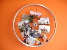 Show off your bike touring photos on a bicycle wheel bulletin board.