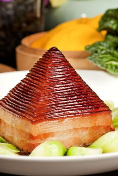 Hangzhou signature dish-pyramid braised soy prok and bamboo shoot serviced with pumpkin bun.