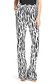 DVF Our twigs print comes to life on the Limited Edition Pop Wrap Elena pant. A wideleg silk jersey trouser that can be worn together with the Reina for the full look. Effortless and on-the-go. Full length. Fit is true to size.
