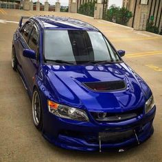 Mitsubishi Lancer Evolution 9 with that rotated turbo setup peeking out in the grill