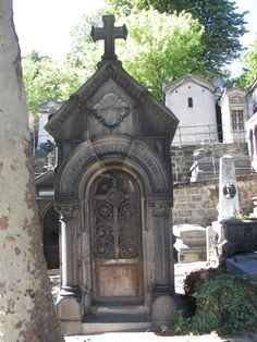 Lovely crypt at Perre Lachaise. Maybe a mini version in the graveyard?