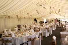 Our efforts at the New House Hotel,Cardiff.  A marquee decorated with a blush, hessian and lace bunting which we named 'Emma' after the bride.  Also shows our hessian table runners, chair bows, wicker heart table centres and rustic jars.
