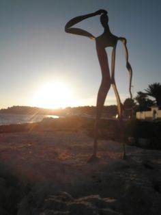 The iron man of Moraira looking out to sea,