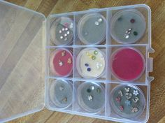 Origami owl storage. At micheals in the beading area for less then $3.50 just add felt for cushion and a pop of color.