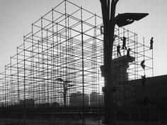 Construction workers in Beijing, China, stand atop scaffolding in this National Geographic Photo of the Day.