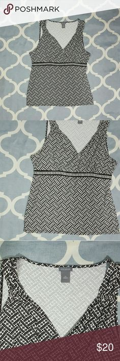 """Ann Taylor wrap sleeveless blouse brown/white XL Ann Taylor women's top. Size XL. Brown/white. Sleeveless, faux wrap style. Viscose/spandex. Length: 27""""  Chest: 17""""  In used condition. B1066 &e Ann Taylor Tops Blouses"""