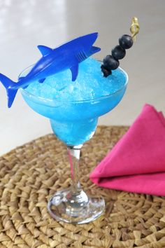 Shark Attack Punch (Blueberry Pineapple Margarita Mix 3 cups water 1 cup blue curacao 3/4 cup blueberry vodka 3 cups lemonade)