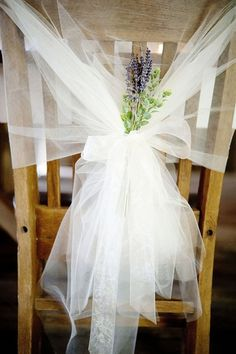 """Simple fabric chair covers, using bridal netting that can be found easily. Chair covers are commonly used in ceremony's and have now worked their way into the reception. However in vintage stylized weddings only the """"bride and groom"""" have elaborate covers."""