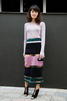 Now I know that horizontal stripes on a plus figure can be really bad and not a pretty sight. However, with black or navy blue across the hip area, this skirt look is rather slimming looking, don't you think? LJH