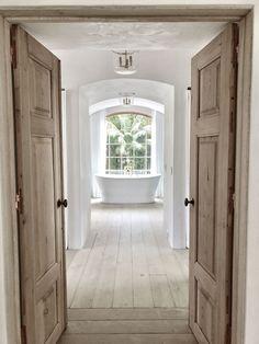 Giannetti Home Malibu project: Master Bath Tub, antique reproduction doors, wood floor