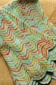 COURANT BABY BLANKET by SARA MORRIS -A delicate knit rippling lace pattern made using two complementary colors of Staccato yarn (soft silk and merino). Pattern is available at Shibui Knits retailers.