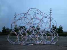 'Hoop-Ball' emerged out of a continued exploration and experimentation with aggregations of mass produced objects. Built at the Free City 2014 two day event in Flint Michigan. Using 160 hula...
