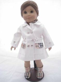 White Designer Raincoat,and Boots for American Girl Doll by Unique Doll Clothing. $20.99. Great Quality. Great for American Girl Dolls.. Fits 18 Inch Dolls. Comes with Matching Boots. White Designer Rain Coat and Boots. This great looking white designer rain coat and matching boots will let your doll make a fashion statement even when the weather is gloomy.  The coat comes with metallic silver buttons, designer pockets and a buckle.  The boots match the jackets pockets.  Thi...