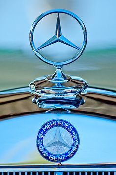 Mercedes Benz Hood Ornament  | More here: http://mylusciouslife.com/stylish-home-luxury-garage-design/