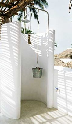 lizard project outdoor shower bucket shower head - outside showers - reminiscent of greece architecture