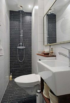 wonderful small bathroom design- gives the illusion of length because the floor til runs up the wall