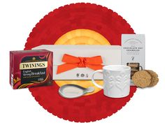 Luxurious large white Twinings gift crate filled with a box of English Strong Breakfast blend, a Repeat Repeat Tom Tom mug, a lovely stainless steel Twinings tea tidy and Cartwright & Butler Chocolate Oat Crumbles.