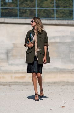 I see a peekaboo of feathers. I am enjoying this trend of mixing dressy pieces with utilitarian designs, like this anorak style of a jacket.