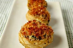 These baked artichoke bottoms filled with spinach and cheese make for elegant appetizers. A no-fail combination of ingredients, sure to be a crowd pleaser and a great way to introduce artichokes to the unfortunate people who have yet to taste them.