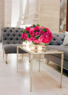 grey tufted couches + beautiful florals