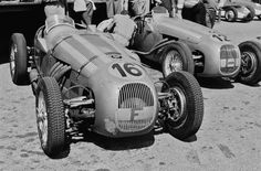 """""""Mailander's lens zooms in on the unique HWM-Alta, car number 16, shown here in the pits at the June 4, 1950 Swiss Grand Prix Formula Two race held in Bremgarten.  Driven and constructed by George Abecassis, originally for the Formula Two class, the HWM later became eligible to compete in Grand Prix events."""" : (16) Rudolf 'Rudi' Fischer - HWM Alta - John Heath - (12) John Heath - HWM Alta - John Heath - VII Prix de Berne 1950 - Bremgarten, Switzerland"""
