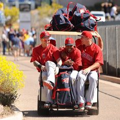 Angles Josh Hamilton, Erick Aybar and Mike Trout catch a ride back to the clubhouse after a full workout at spring training.