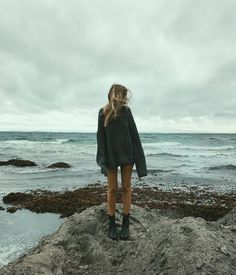 we love fashion. ocean, big chunky sweater, boots, fall mornings