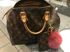 Louis Vuitton Monogram Speedy 30 with Monogram Key Cles and XL Michael Kors Pom Pom bag charm