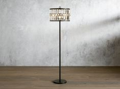 Iron and crystals come together beautifully to ignite timeless luxury for your living space. Crystals are framed by a dark bronze finish, creating an aesthetic reminiscent of antique windows. Floor Lamp, Lamp, Flooring, Reading Lamp Floor, Lighting, Arhaus, Contemporary, Iron Floor Lamp, Contemporary Floor Lamps