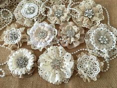 5 shabby chic vintage lace handmade flowers I made these flower lace with vintage cotton lace doilies, eylet lace trim and metal rhinestone - pearl buttons. approximately 2.5 3.5 ***Shabby chic lace flowers are perfect for any kind of embellishing. They can be added to headbands, hair clips, brooch pins, bridal bouquets, mason jars, vases, purses, tables, pillows, and much more.*** After i receive payment, please EXPECT approximately 1 to 2 weeks for your item to be made and prepared for ...