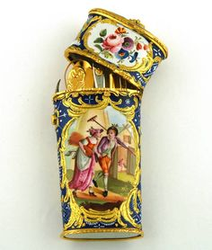 'The Haymakers' Etui large cobalt-ground etui with raised white geometric patterns. The front and back have 2 vignettes decorated with polychrome scenes; a couple taking a stroll and 'The Haymakers'.  The internal components comprise of: folding fruit knife, snuff spoon, pencil and ivory writing tablet, scissors , bodkin and a combined steel tweezers and file. Bilston c1770