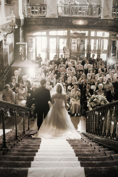 I love how old-world this photo looks... COULD BE COOL W BRIDAL PARTY AND PARENTS AT BOTTOM OF WISTARIAHURST STAIRS