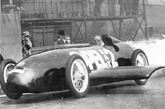 1928 - May 23rd - Fritz von Opel's, Rocket-RAK Car, Powered by 24 Solid-Fuel Rockets Set a New World Land Speed Record of 148 mph at the Avus Track in Berlin, Germany
