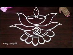 It is our tradition to draw kolam every day morning at the door steps. There are many benifits of drawing kolam in front of the house. It is auspecious and b. Easy Rangoli Designs Diwali, Rangoli Simple, Rangoli Designs Latest, Simple Rangoli Designs Images, Rangoli Designs Flower, Free Hand Rangoli Design, Rangoli Border Designs, Small Rangoli Design, Rangoli Designs With Dots