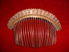 Empire Comb Tiara. c. 1800-1825. Rosenbach Museum & Library. The tiara, or hair comb, is gilded metal set with amethysts and faux pearls surrounded by carvings of leaves and geometric shapes.