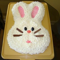 How about a buttercream frosting or a whipped cream frosting?? Build peaks with the spatulas and then use flaked coconut for a real furry bunny!! Keep bunny detail light and simple for a real stylish cake #LizaLovess