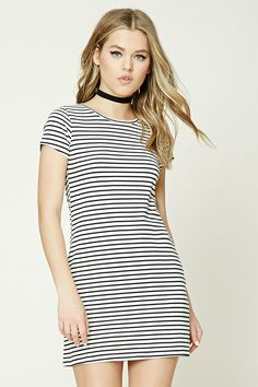 This knit T-shirt dress features a round neck, short sleeves, and allover horizontal stripes.